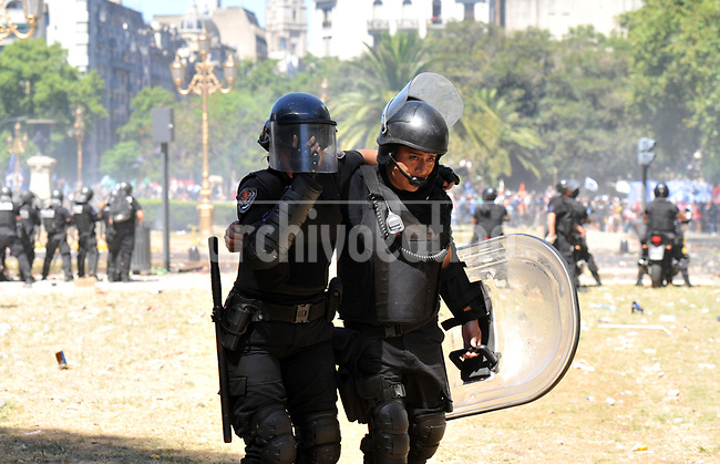 Police protect themselves with shields during severe riots  while the Congress was discussing modifications in a  retirement law.
