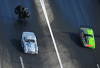 Apr. 28, 2012; Baytown, TX, USA: Aerial view of NHRA pro mod driver Brad Brand (left) races alongside Chip King during qualifying for the Spring Nationals at Royal Purple Raceway. Mandatory Credit: Mark J. Rebilas-