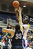 Timmy Awosika #55 of South Side, right, looks to get a shot past Zach Bromfeld #33 of Hewlett during the Nassau County varsity boys basketball Class A semifinals at Hofstra University on Wednesday, Feb. 24, 2016. South Side won by a score of 48-47.