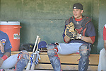 18 August 2012: Brooklyn Cyclones catcher Jeffrey Glenn sits in the dugout prior to a game against the Vermont Lake Monsters at Centennial Field in Burlington, Vermont. The Lake Monsters defeated the Cyclones 4-1 in NY Penn League action. Mandatory Credit: Ed Wolfstein Photo