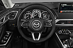 Car pictures of steering wheel view of a 2016 Mazda CX-9 Touring-FWD 5 Door SUV Steering Wheel