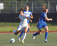 Western New York Flash midfielder Carli Lloyd (10) passes the ball as Boston Breakers midfielder Heather O'Reilly (9) defends.  In a National Women's Soccer League (NWSL) match, Boston Breakers (blue) tied Western New York Flash (white), 2-2, at Dilboy Stadium on August 3, 2013.