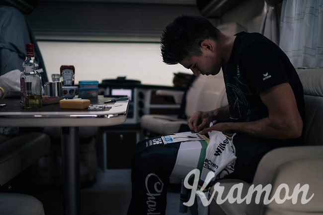 CX World Champion Wout Van Aert (BEL/Crélan-Charles) preparing for the race in his camper; pinning on his #1 race number<br /> <br /> Super Prestige Ruddervoorde / Belgium 2017