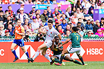 Mfundo Ndhlovu of South Africa (R) puts a tackle on Callum Sirker of England (L) during the HSBC Hong Kong Sevens 2018 match between South Africa and England on April 7, 2018 in Hong Kong, Hong Kong. Photo by Marcio Rodrigo Machado / Power Sport Images