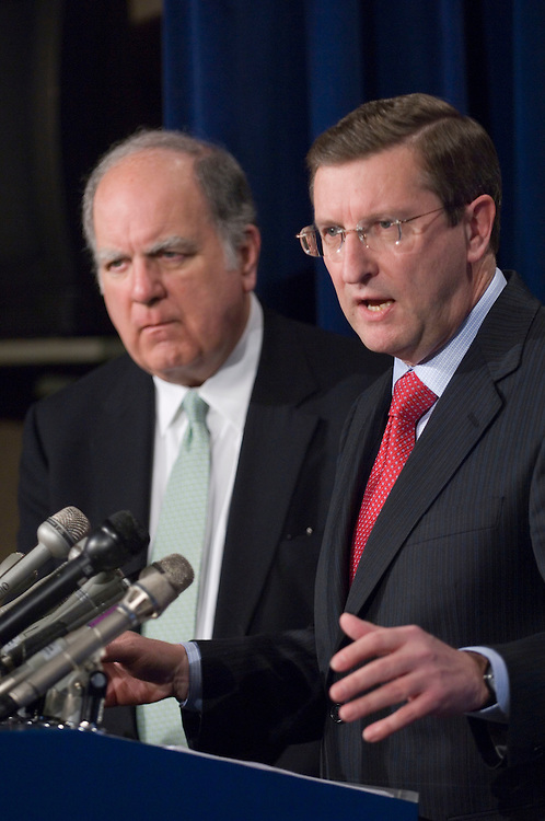 "02/05/07--House Budget Chairman John M. Spratt Jr., D-S.C., and Senate Budget Chairman Kent Conrad, D-N.D., during a news conference on the the President's fiscal 2008 budget proposal, which was delivered earlier in the day to the U.S. Capitol. President Bush's $2.9 trillion budget proposal for fiscal 2008 squeezes discretionary spending on domestic programs in favor of a continued buildup in military and war spending. The budget sent to Congress Monday proposes significant policy changes to restrain Medicare, Medicaid and other entitlement spending as part of a plan to balance the federal budget by fiscal 2012. The presidentÕs proposed budget, the first of his presidency to face a Democratic-controlled Congress, includes $929.8 billion in discretionary spending, up $57 billion or 6.5 percent. That figure does not include a proposed $145 billion in fiscal 2008 spending on the wars in Iraq and Afghanistan. The president also has sought an additional $99.6 billion in war spending for the remainder of fiscal 2007 plus $3.4 billion in additional fiscal 2007 spending on hurricane relief. All but $3.6 billion of the overall discretionary spending increase for fiscal 2008 would be funneled toward security-related spending, resulting in a near freeze to domestic spending accounts. The budget, ""The Budget of the United States Government, Fiscal Year 2008,"" is available in printed and electronic versions. The complete printed set of four volumes is 2,186 pages long, and weighs about 10 pounds.  Congressional Quarterly Photo by Scott J. Ferrell"