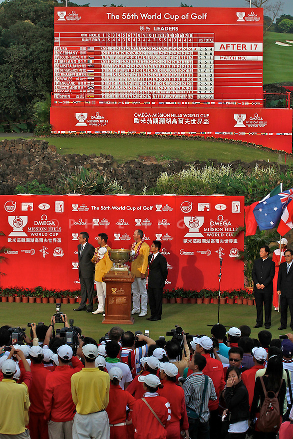Gary Woodland and Matt Kuchar of USA during the prizegiving ceremony after the final round of the Omega Mission Hills World Cup played at The Blackstone Course, Mission Hills Golf Club on November 27th in Haikou, Hainan Island, China.( Picture Credit / Phil Inglis )