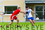 Colm &Oacute; Muircheartaigh, An Ghaeltacht tackles Jack Daly, St Mary's during their Intermediate semi final in Killorglin on Sunday.<br /> View 2 Related Assets