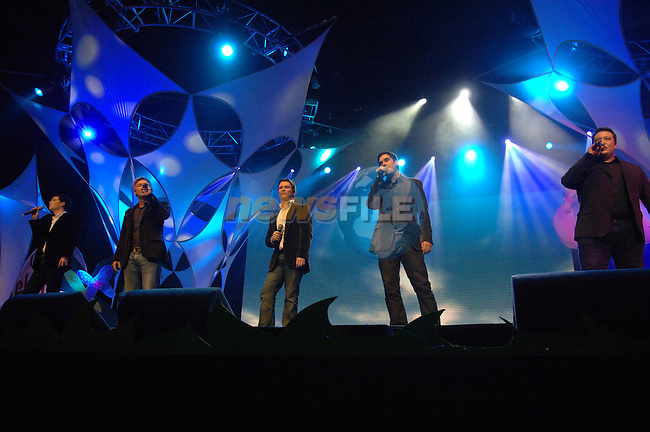 G4 and Stephen Gately on stage at the 2007 Childline Concert in the Point Depot in Dublin....Photo NEWSFILE/Colin Bell.(Photo credit should read Colin Bell/NEWSFILE)....This Picture has been sent you under the condtions enclosed by:.Newsfile Ltd..The Studio,.Millmount Abbey,.Drogheda,.Co Meath..Ireland..Tel: +353(0)41-9871240.Fax: +353(0)41-9871260.GSM: +353(0)86-2500958.email: pictures@newsfile.ie.www.newsfile.ie.FTP: 193.120.102.198.