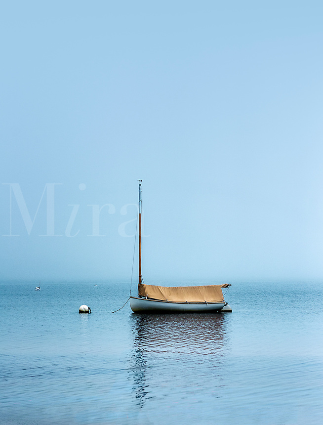 Boat in Pleasant Bay on overcast morning.