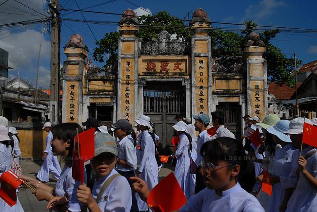 Vietnamese students at a parade in Hoi An, Vietnam.