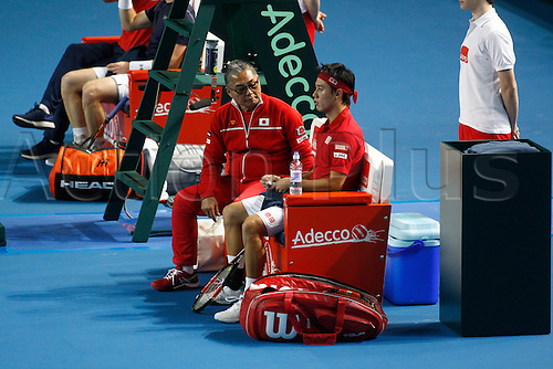 06.03.2016. Barclaycard Arena, Birmingham, England. Davis Cup Tennis World Group First Round. Great Britain versus Japan. Japan team captain Minoru Ueda and Kei Nishikori during a change of ends.