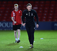 Lincoln City U18's professional development phase lead Tom Shaw during the pre-match warm-up<br /> <br /> Photographer Andrew Vaughan/CameraSport<br /> <br /> The FA Youth Cup Second Round - Lincoln City U18 v South Shields U18 - Tuesday 13th November 2018 - Sincil Bank - Lincoln<br />  <br /> World Copyright © 2018 CameraSport. All rights reserved. 43 Linden Ave. Countesthorpe. Leicester. England. LE8 5PG - Tel: +44 (0) 116 277 4147 - admin@camerasport.com - www.camerasport.com
