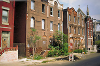 City decay is shown in boarded up houses. Philadelphia Pennsylvania United States North Philadelphia.