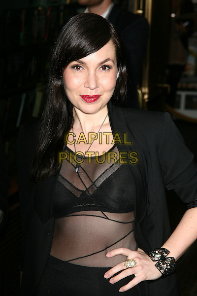FABIOLA BERACASA .New York City premiere of 'The Runaways' at Landmark Sunshine Cinema, New York City, USA, .17th March 2010..half length black sheer see through thru red lipstick hand on hip make-up ring cuff bracelet necklace .CAP/ADM/PZ.©Paul Zimmerman/AdMedia/Capital Pictures.