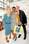 Betsey Johnson, Nesta Findlay, and guest pose at the CURVE and CFDA Party For A Cause event during the CURVENY Lingerie & Swim show, at the Jacob Javits Convention Center, August 2, 2010.
