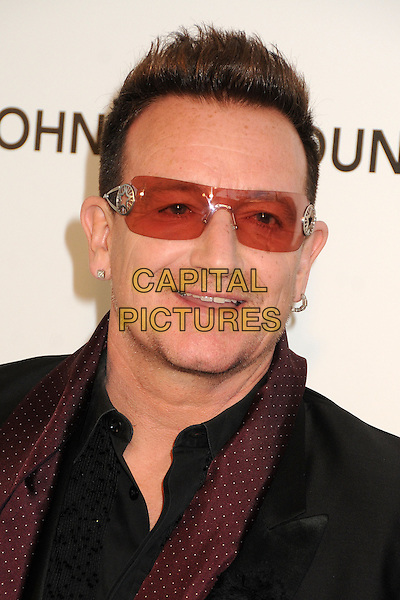 Bono of U2 (Paul David Hewson).21st Annual Elton John Academy Awards Viewing Party held at West Hollywood Park, West Hollywood, California, USA..February 24th, 2013.oscars headshot portrait red black sunglasses shades.CAP/ADM/BP.©Byron Purvis/AdMedia/Capital Pictures.