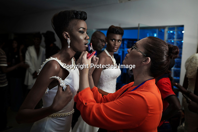 KINSHASA, DRC - JULY 19: Models have their make up and are dressed in wedding gown backstage by the London based Nigerian designer Yemi Osunkoya on July 19, 2014. Local and invited foreign-based designers showed their collections during the second edition of Kinshasa Fashion week. (Photo by Per-Anders Pettersson)