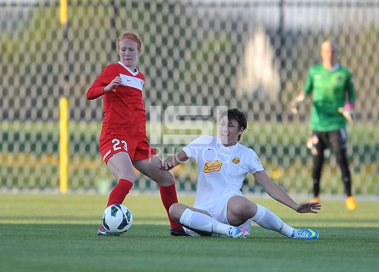 Abby Wambach (20) of The Western New York Flash gets fouled by Tori Huster (23) of the Washington Spirit.  The Washington Spirit tied The Western New York 1-1 in the home opener of The National Women's Soccer League, at Maryland SoccerPlex, Saturday April 20, 2013.