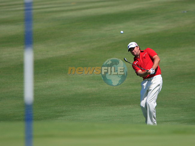 Graeme McDowell (N.IRL) chips onto the 14th green during the morning session on Day 3 of the Volvo World Match Play Championship in Finca Cortesin, Casares, Spain, 21st May 2011. (Photo Eoin Clarke/Golffile 2011)