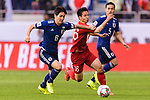 Do Hung Dung of Vietnam (C) fights for the ball with Haraguchi Genki of Japan (L) during the AFC Asian Cup UAE 2019 Quarter Finals match between Vietnam (VIE) and Japan (JPN) at Al Maktoum Stadium on 24 January 2018 in Dubai, United Arab Emirates. Photo by Marcio Rodrigo Machado / Power Sport Images
