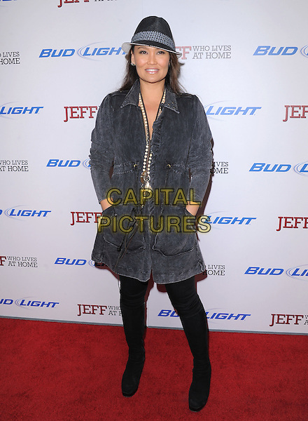 """Tia Carrere.""""Jeff, Who Lives At Home"""" Los Angeles Premiere held at the Directors Guild of America, West Hollywood, California, USA..March 7th, 2012.full length black blue grey gray coat jacket hat hands in pockets .CAP/RKE/DVS.©DVS/RockinExposures/Capital Pictures."""