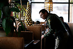 Carson City Sheriff's Reserve Tulio Marroquin talks to guests as first responders from around the area wait on diners at Bodines as part of the Feast with a Hero fundraiser in Carson City, Nev., on Saturday, Dec. 15, 2018. <br /> Photo by Cathleen Allison/Nevada Momentum