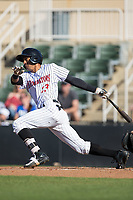 Joel Booker (23) of the Kannapolis Intimidators follows through on his swing against the Lakewood BlueClaws at Kannapolis Intimidators Stadium on April 9, 2017 in Kannapolis, North Carolina.  The BlueClaws defeated the Intimidators 7-1.  (Brian Westerholt/Four Seam Images)