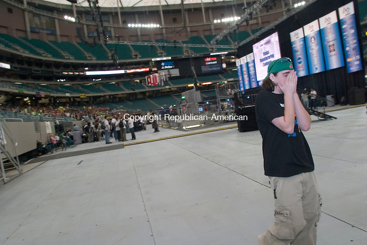 ATLANTA, GA- 29 APRIL 2006- 042906JT03-<br /> Patrick Fagan, of Nonnewaug High, covers his face on the floor of the Georgia Dome in Atlanta after his team's alliance lost a match in which his team's robot lost power during the qualifying rounds of the 2006 FIRST Robotics Championship Saturday. <br /> Josalee Thrift Republican-American
