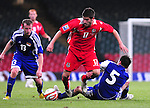 Ched Evans gets away fron Andreas Gerster's tackle. Wales V Liechtenstein, 2010 World Cup Qualifying Group 4 © Ian Cook IJC Photography iancook@ijcphotography.co.uk www.ijcphotography.co.uk