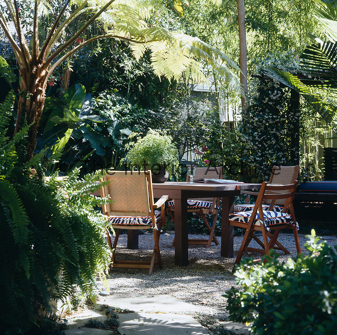 The secluded and lushly planted rear garden provides an idyllic spot for outside dining