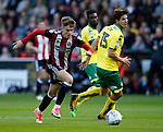 David Brooks of Sheffield Utd drifts the ball past Time Klose of Norwich City during the Championship match at Bramall Lane Stadium, Sheffield. Picture date 16th September 2017. Picture credit should read: Simon Bellis/Sportimage
