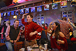 University of Alabama football fans are seen during the College Football Bowl Championship Series, BCS, final at Moe's Barbeque on University Boulevard in downtown Tuscaloosa, Alabama on January 7, 2013.  Alabama beat Notre Dame 42-14.
