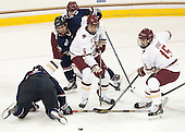 Scott Savage (BC - 2), Brent Norris (UConn - 13), Steve Santini (BC - 6), Cam Spiro (BC - 15) - The Boston College Eagles defeated the visiting University of Connecticut Huskies 3-2 on Saturday, January 24, 2015, at Kelley Rink in Conte Forum in Chestnut Hill, Massachusetts.