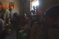 Burgi men drink and talk in a village bar in Jiojio Ethiopia