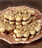 Linzer Cookies filled with Raspberry Jam and topped with Hazelnuts