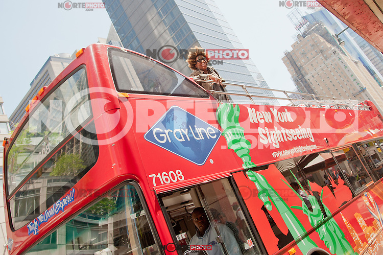 """Macy Gray at the unveiling of the """"Macy Gray"""" Gray Line Bus at 777 8th Avenue on May 18, 2012 in New York City. © Kristen Driscoll / Mediapunch Inc."""