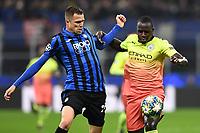 6th November 2019, Milan, Italy; UEFA Champions League football, Atalanta versus Manchester City; Josip Ilicic of Atalanta challened by Benjamin Mendy of Man City