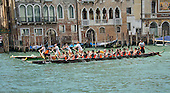 "Rowers from many countries participate in the 42nd Vogalonga regatta on the Grand Canal near the the Basilica della Salute in Venice, Italy on Sunday, May 15, 2016.  The Vogalonga, a non-competitive recreational sporting event for amateur athletes, is part of the annual ""Venice International Dragon Boat Festival.""  The Grand Canal is closed to motor-driven boats during the event.<br /> Credit: Ron Sachs / CNP"