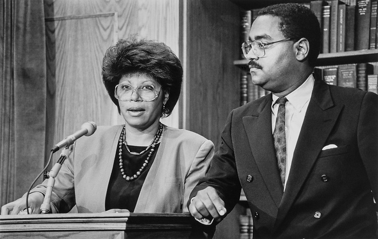 Alma Newsom, communications director for Rep. Mickey Leland and Rodney Ellis, now Houston City Council member at Leland press conference on Jan. 10, 1989. (Photo by CQ Roll Call)