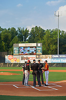 Bowie Baysox manager Buck Britton (15) during the lineup exchange with umpires Greg Roemer, Mike Snover, Aaron Higgins, and Richmond Flying Squirrels coach Lipso Nava (17) before an Eastern League game on August 15, 2019 at Prince George's Stadium in Bowie, Maryland.  Bowie defeated Richmond 4-3.  (Mike Janes/Four Seam Images)