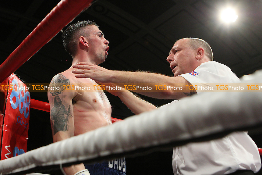 Carl Frampton (black shorts) defeats Kris Hughes in a Super-Bantamweight boxing contest for the Commonwealth Title at York Hall, Bethnal Green, promoted by Matchroom Sports - 28/01/12 - MANDATORY CREDIT: Gavin Ellis/TGSPHOTO - Self billing applies where appropriate - 0845 094 6026 - contact@tgsphoto.co.uk - NO UNPAID USE.