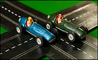 BNPS.co.uk (01202 558833)<br /> Pic: PhilYeomans/BNPS<br /> <br /> An original set from 1957.<br /> <br /> These fascinating photos tell the story of 60 years of Scalextric which grew from humble beginnings into a British institution. <br /> <br /> When enterprising Freddie Francis launched the car racing toy in 1957 at his factory in Havant, Hants, he could never have known they would still be a household name 60 years later.<br /> <br /> Today, Scalextric are produced by English toy maker Hornby Hobbies and demand for the much-loved slot cars is still as strong as ever.