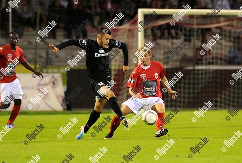 2013-09-27 / Voetbal / seizoen 2013-2014 / R. Antwerp FC - Virton / Yohan Dufour met Roy Bakkenes van Antwerp (r.)<br /><br />Foto: Mpics.be