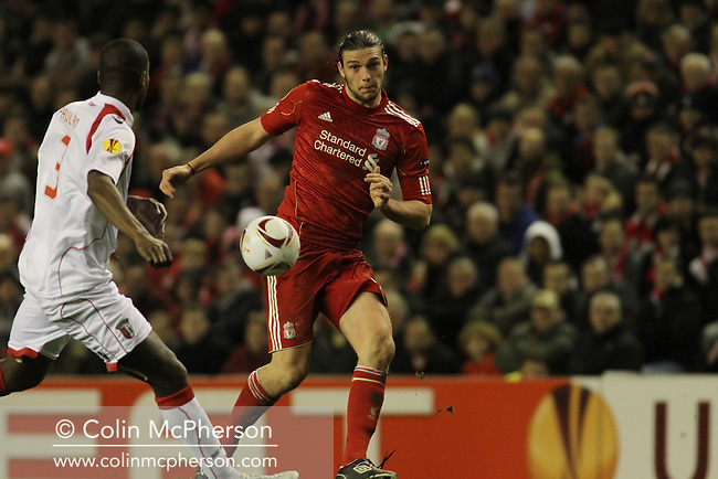 17.03.2011 Europa League Football from Anfield. Liverpool v Braga. Liverpool forward Andy Carroll (red shirt) challenges for the ball during the second half.