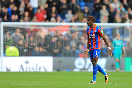 28th October 2017, Selhurst Park, London, England; EPL Premier League football, Crystal Palace versus West Ham United; Wilfried Zaha of Crystal Palace celebrates after scoring as he makes it 2-2