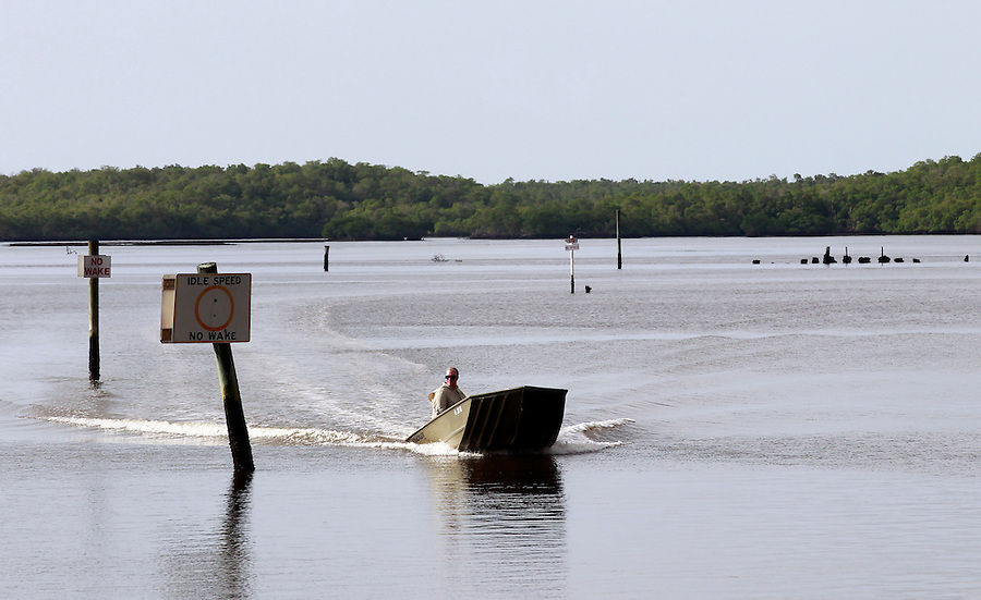A boater makes his way through the channel in the Florida Everglades and the 10,000 islands out of Chokoloskee Island. Photo/Andrew Shurtleff