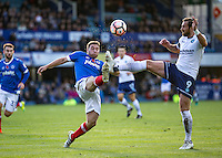 Adam Buxton of Portsmouth and Paul Hayes of Wycombe Wanderers during the FA Cup 1st round match between Portsmouth and Wycombe Wanderers at Fratton Park, Portsmouth, England on the 5th November 2016. Photo by Liam McAvoy.
