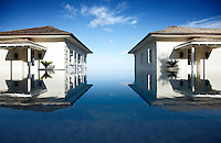 Two private villas are set either side of an infinity pool and look out over the sea beyond.