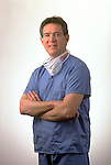 portrait of surgeon with folded arms