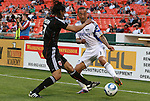 05 May 2010: Kansas City's Ryan Smitt (11) and DC's Juan Manuel Pena (3). DC United defeated the Kansas City Wizards 2-1 at RFK Stadium in Washington, DC in a regular season Major League Soccer game.